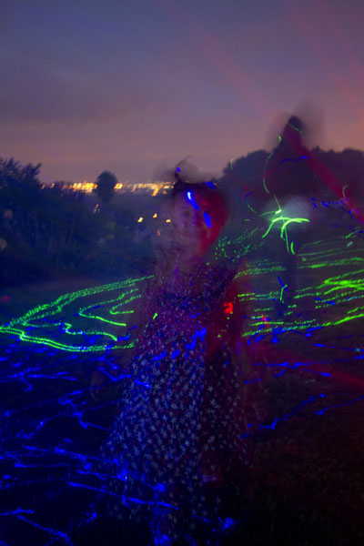little girl playing in laser lights