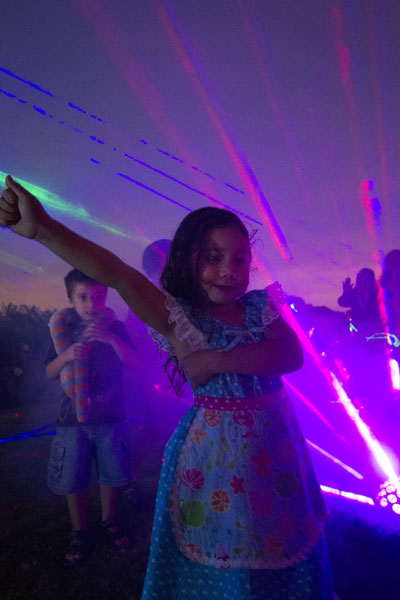5year old girl playing in lights and smoke.