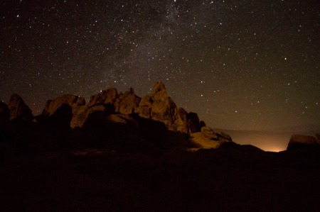 Milky Way with rocks in foreground. Car lights paint rocks.