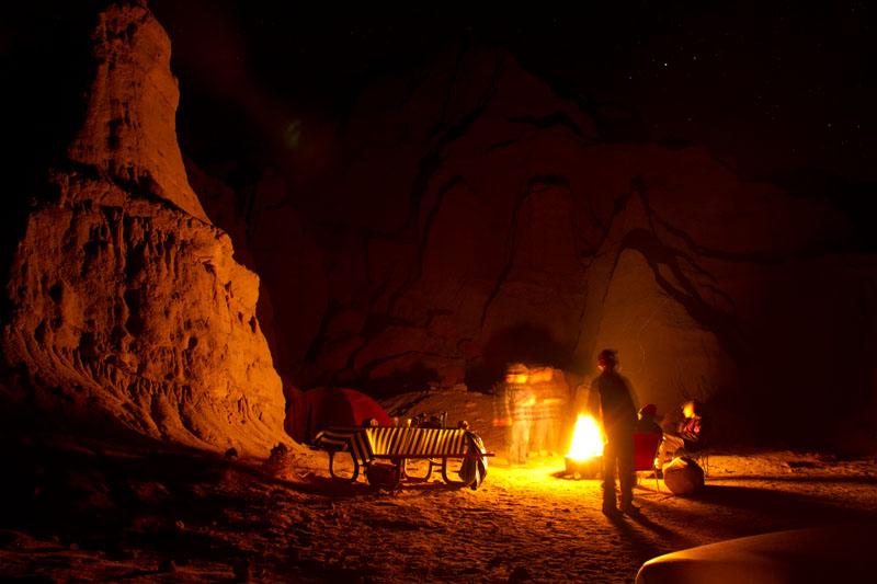Campfire light reflecting on rocks.