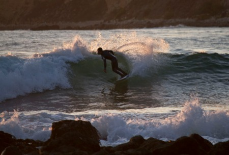 Surfer cutting back on a wave