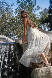 Model beside waterfall. 2014