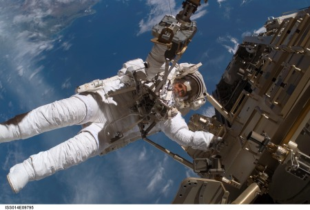 Figure in spacesuit at ISS.
