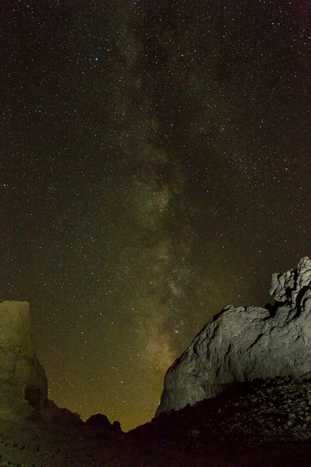 Milky way in sky with light painting on Trona Pinacles rocks.