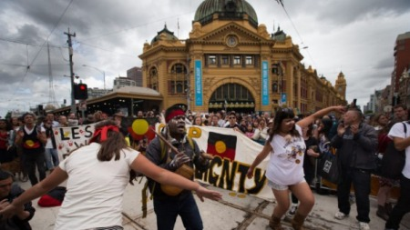 Hundreds of Invasion Day protesters march at the back of the Australian Day Parade in Melbourne's CBD. Photo: Jason South